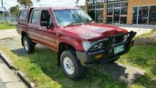 1997 Toyota Hilux LN106R Tamworth Red Mica 5 SPEED Manual Utility Deagon Brisbane North East Preview