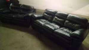 BLACK LEATHER LOVE SEAT AND BLACK LEATHER COUCH. FREE DELIVERY