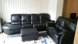 Reid's Natuzzi genuine leather sofa.