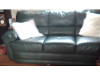 2 and 3 seater real leather sofas in deep green colour in very good condition .