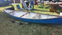Canoe, paddles and trolling motor for trade or sale.