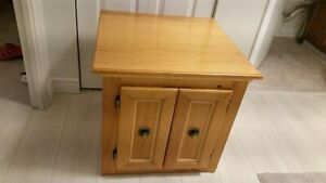 Two identical pine end tables