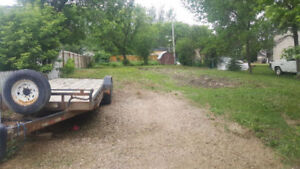 Lot For Sale In Pense.  Small Town Living Minutes From The City!