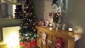 6ft artificial Christmas tree with lights and baubles