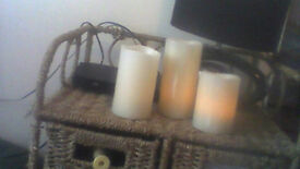 set of 3 flameless candles which light up small battery in base shows a flickering flame