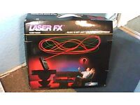 LASER FX - LASER TYPE LIGHTS LINKED TO YOUR MUSIC SYSTEM-STILL IN BOX