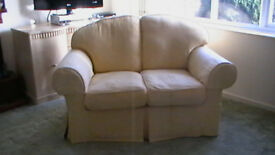 2-seater sofa with removable washable covers.