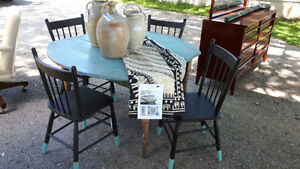 Antique Farmhouse Harvest Table with Painted Black Chairs