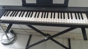 Yamaha NP11 digital piano with stand.