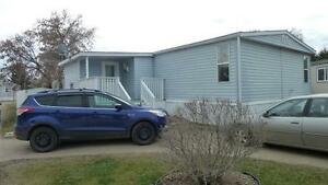 SPACIOUS COUNTRY COTTAGE  - DBL WIDE MOBILE @ $87,000.00