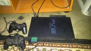 Original Playstation 2 + 2 Controllers and memory card