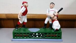HEAVY CAST IRON BASEBALL HOMETOWN BATTERY COIN BANK. ANTIQUES.