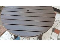 Wooden round garden table