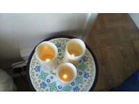 THREE flameless candles have a battery in them working fine in good condition