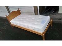 Solid pine single bed with top quality mattress, both in good condition