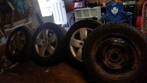 Winter tires and rims 114.3x5 215 60 r16