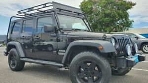 2009 Jeep Wrangler JK MY2010 Unlimited Sport Black 4 Speed Automatic Softtop Bungalow Cairns City Preview