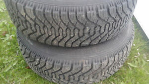 SNOW TIRES P215/65/R16 GOODYEAR SET OF TWO $150.00 (NPG22091)