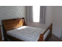 Lovely solid wood king size bed (inc. mattress).