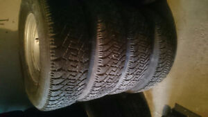 4 Goodyear Nordic. 235 75 15. GM 5x127 Rims