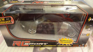 Brand New Remote-Controlled Vehicle and Boxing Robots, $29