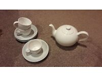 18 plain white cups and saucers with teapot