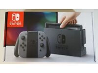 Nintendo Switch in grey with games
