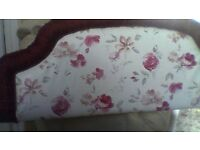 double headboard with vynly covering in a tasteful floral pattern in pinks and cerise
