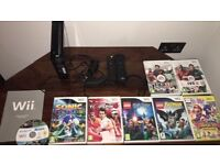 Wii console with games & 2 remote controls & 2 nunchucks