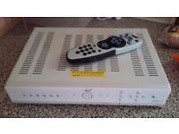 Sky + white box with remote