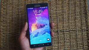 Unlocked and New Samsung Galaxy Note 4 Charcoal 32GB - $320