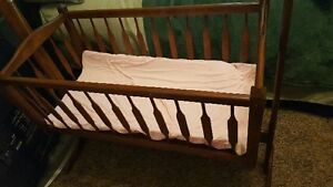 Wooden cradle on stand
