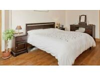 Two rooms worth of beautiful and quality bedroom furniture.