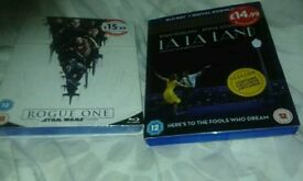 New unwanted gift blue ray DVD la la land and star wars rouge one