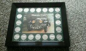 Historic cars coin collection 20 in a mant and framed 11in by 9in