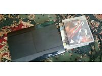 Ps3 super slim black 500gb with 4 games 1 controller