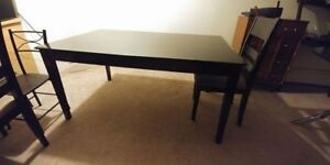 Big brown black dining table with 3 free unmatched chairs