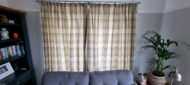 Green and naturals lined tartan curtains.