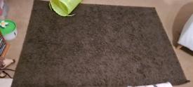 Next large brown rug