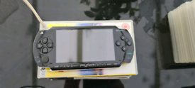 PSP (with 6 games and 2 films)