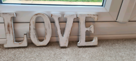 Small wooden love letters.