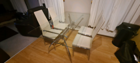 Glass table with 4 cream leather chairs