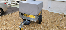 Erde 122 Trailer with high mesh sides