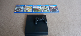 Ps4 with 5 games.
