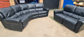 Black leather corner electric sofa with 2 seater electric recliner.