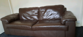 Brown, large two seater sofa.