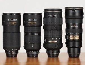 FOUR !  NIKON autofocus f2.8 zooms to 200mm at $500 to $1400