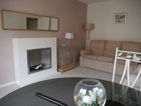 Central,lovely modern 2 bedroom flat with secure entry and allocated private parking.