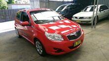 2010 Holden Barina TK MY10 Red 5 Speed Manual Hatchback Lidcombe Auburn Area Preview