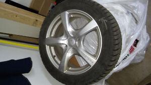 4 pneus Falken + 4 mags, kit presque neuf